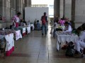 Arches of Palacio Municipal. Huichols selling handicrafts