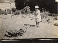 Mom, age 3, with the lawn mower. 1926