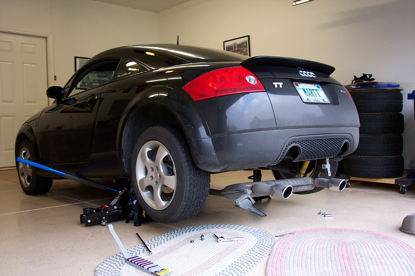 Time to lube the sway bar. Rear of car on jackstands - no need to take wheels off. Drop exhaust - support with jack.