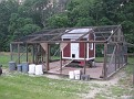 """""""Happy Hens Poultry Place""""  I built all of this summer 2007 from 20 year old pens that I had made when my kids, Gary Jr., and Alaina, were small."""