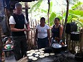 Visiting people in a small hillside village in Copan, Honduras...  They are showing me how to make tortillas :-)