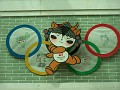 The Olympics are coming, and China has a quintet of uniquely appealing mascots.  On this kite, one plays volleyball like Kat, one is doing Martial Arts like James, so I took a picture in spite of the fact that on is doing the gymnastics thing with twirly