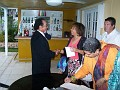The Arstist welcoming Yanick Fulgueira and her husband, Klosa signing the guest book