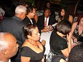 Arriving guests having their CDs autographed