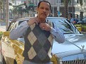 Frankie posing in front of a Rolls Royce on Rodeo Dr.