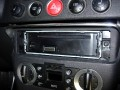 Head unit pushes in and locking pins align with mounting sleeve