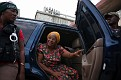 Haitian presidential candidate Manigat steps out of a car as she prepares to meet students at a school in Port-au-Prince