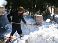 Dylan is digging out their Mailbox so they can get mail delivery.  Mail Carriers are not allowed by law to leave the postal vehicle to reach mailboxes buried in snow.