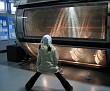 Energetic child near a high-energy particle detector