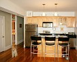 Kitchen with large black granite island