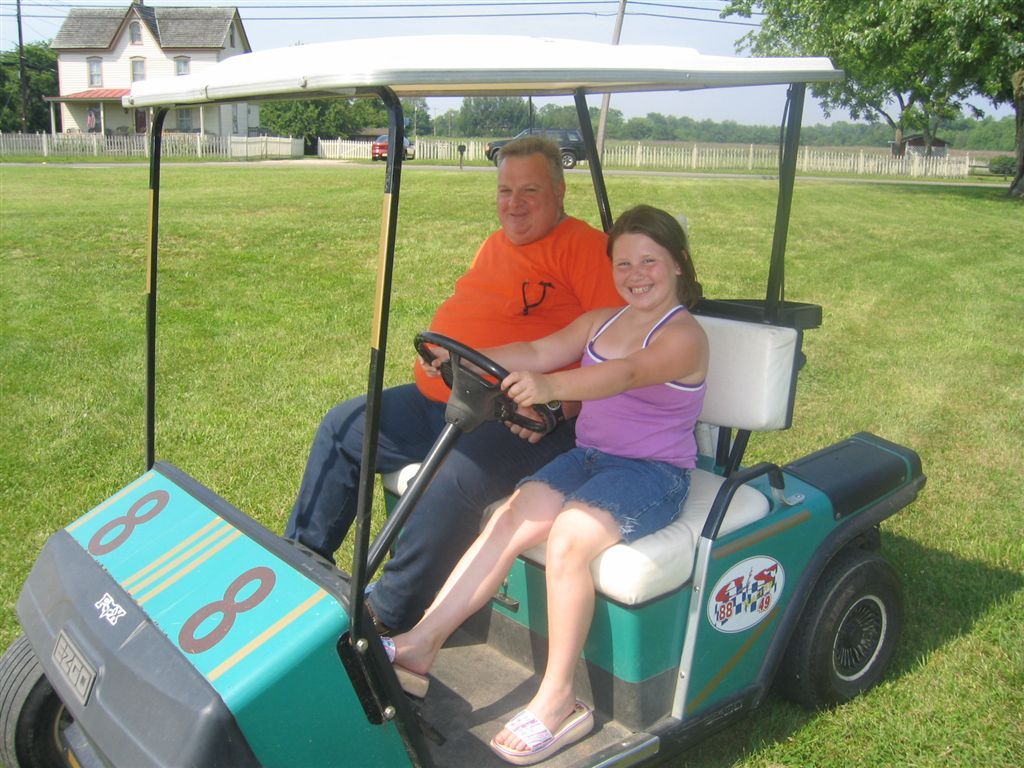 Jimmy and Madison on the Golf Cart Goofing Around!!!  ( 6-25-2003)