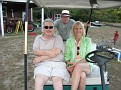 Anita, Ed and Allen on my golf cart back at the Farm field.