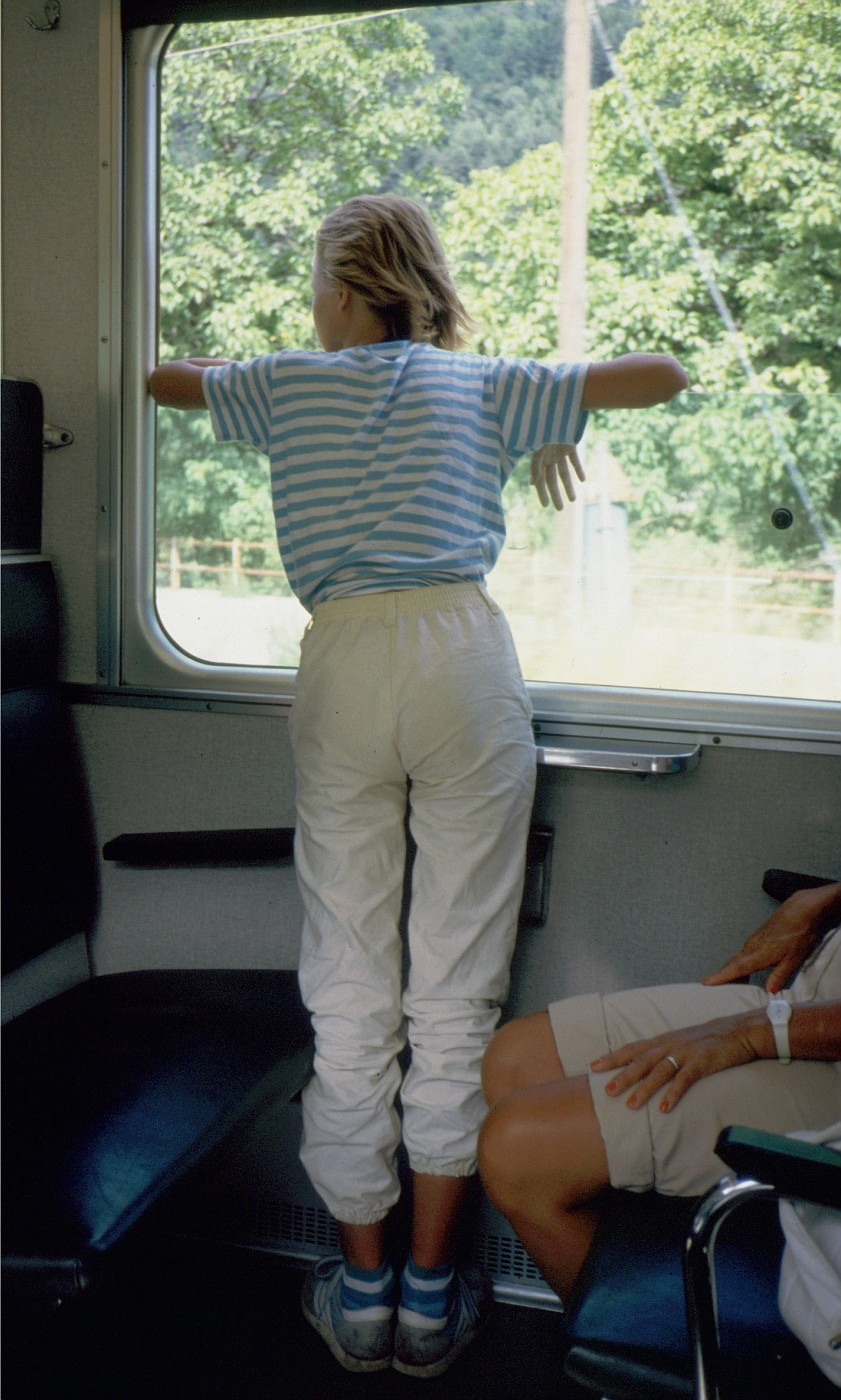 1986-08 1767 Sonja looks out of the window;  Narrow gauge train