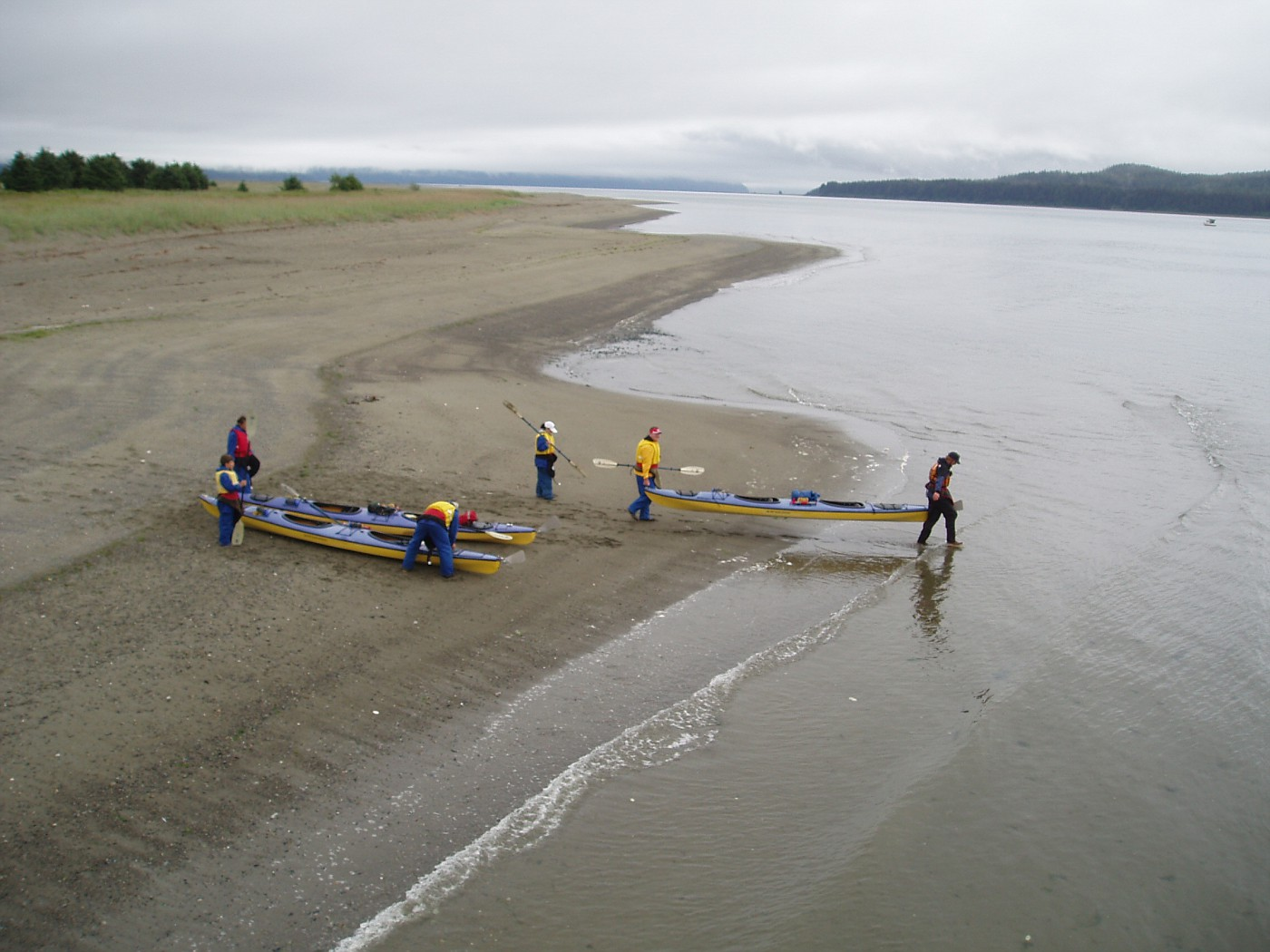 Kayakers take off from the Gustavus beachfront
