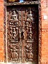 Buddhist themed carved doors